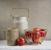 Old rustic aluminum cookwares and apples Stock Images