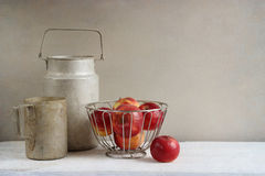 Old rustic aluminum cookwares and apples Royalty Free Stock Photography