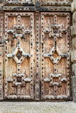 Old rustic ancient vintage wooden closed door with detailed ornaments Royalty Free Stock Images