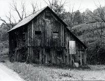 Old, Rustic Barn. Abandoned barn in disrepair media is black and white Stock Photos