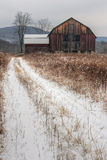 Old Rustic Barn and Snow. A winter snow scene of a rustic old barn Stock Photo