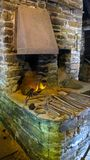 Old rustic Blacksmith Forge with tools. This is a picture of an old rustic blacksmith forge, with the open fire and blacksmith tools stock image