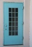 An old rustic blue metal door with silver doorknob Royalty Free Stock Photo