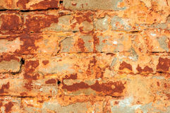 Old rustic brick wall with cracked stucco Stock Photo
