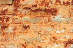 Old rustic brick wall with cracked stucco Royalty Free Stock Photography
