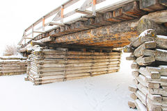 Old rustic bridge over the frozen river - photo taken in the winter Royalty Free Stock Photo