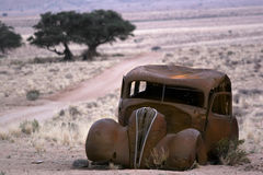 Old rustic car. Old abandoned rustic car in a landscape environment Royalty Free Stock Photos