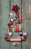 Old rustic children toys decoration for christmas in form of a t Royalty Free Stock Photo