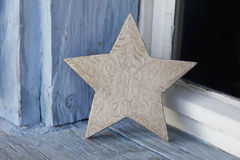 Old rustic christmas star on an old windowsill in blue and white Royalty Free Stock Photos