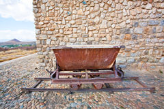 Old rustic coal mine trolley on the rails stock photo