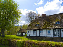 Old rustic countryside farmhouse with thatched roof Stock Photography