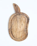 Old rustic cutting board made of olive wood on a white backgroun Stock Images