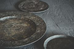 Old and rustic dishes. Dark tones Royalty Free Stock Image