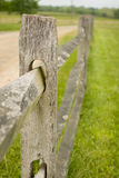 Old rustic fence. Old rustic wooden picket fence on a farm next to a dirt road Royalty Free Stock Photo