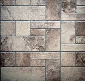 Old rustic floor with aged stone tiles of different sizes geometrically arranged.  royalty free stock image