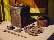 Old rustic gardening farm tools and utensils on the porch of a village house. royalty free stock photos