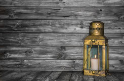 Old rustic golden lantern on wooden old shabby background for co Royalty Free Stock Image