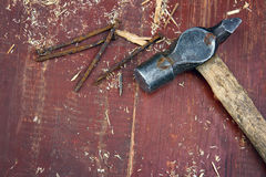 Old hammer on old wooden background Royalty Free Stock Photo