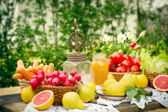 Old rustic hand blender and fruits and vegetables. On table Stock Photos