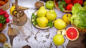 Old rustic hand blender and organic fruits and vegetables Stock Images