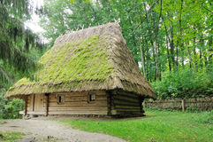Old rustic house ukrain. Old Ukrainian peasant hut covered with straw royalty free stock photography