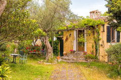 Old Rustic House, Valldemossa, Mallorca. Interesting old ochre coloured rustic house on the edge of Valldemossa, Mallorca Royalty Free Stock Images