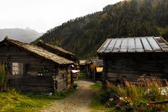 Old rustic houses in Swiss mountains royalty free stock photo