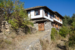 Old rustic houses. Traditional Bulgarian rustic houses in ethnographic reserve of Kovachevitza, Bulgaria Stock Images