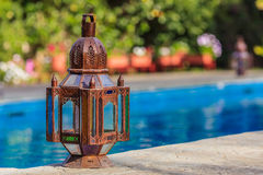 Old rustic lamp. Standing next to the swimming pool Royalty Free Stock Images