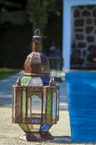 Old rustic lamp. Wrapped in a spider web, next to the swimming pool Stock Image