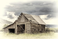 Old rustic log barn in Rocky Mountains royalty free stock photography