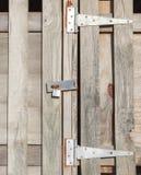 Old rustic padlock on wooden door in countryside. Stock Image