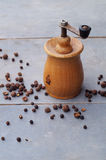 Old rustic pepper mill and peppercorns Royalty Free Stock Image