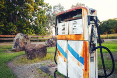 Old rustic pump at an abandoned fuel station Royalty Free Stock Photo