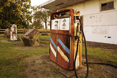 Old rustic pump at an abandoned fuel station Royalty Free Stock Image