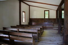 Old rustic room with long wood benches Royalty Free Stock Images