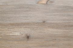 Old rustic scratch and damage grey wood texture close-up as background. Old rustic scratch and damage grey wood texture close-up as background royalty free stock photos