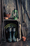 An old rustic shed with garden tools and clay pots Stock Photos