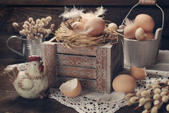 Old rustic still life with eggs in nest on wooden box for easter Royalty Free Stock Photos