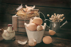 Old rustic still life with eggs in vintage wooden bucket for eas Royalty Free Stock Photography