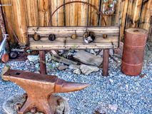 Old Rustic stocks and anvil Shack with Antique junk all around stock photos