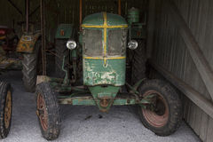 Old rustic tractor in a barn Stock Photography