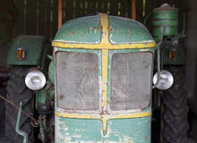 Old rustic tractor in a barn Royalty Free Stock Photo