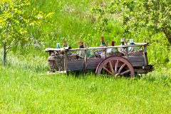 Old Rustic wagon with wine bottles Royalty Free Stock Photography