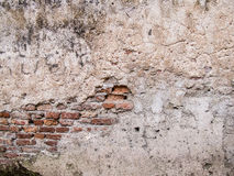 Old rustic wall. With crack to show brick inside Stock Image