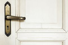 Old rustic white door detail. Old rustic wooden white door detail with door handle Royalty Free Stock Photography