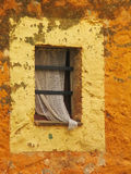 Old rustic window. Colorful rustic window in an old farm's wall Stock Image