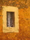 Old rustic window. Colorful rustic window in an old farm's wall Stock Photo
