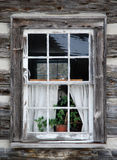 Old rustic window. Old and weathered window on a log home royalty free stock images