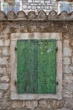 Old rustic window closed shutters Royalty Free Stock Photography